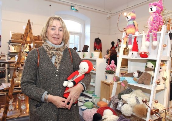 Craft member Valerie Harris with some of her knitted and crochet toys and accessories.