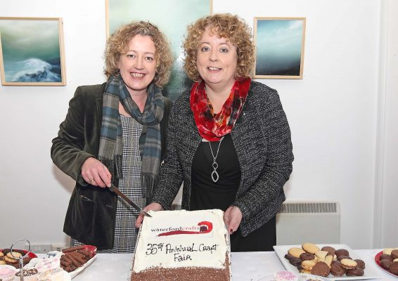 Garter Lane Arts Centre Executive Director with Waterford Crafts PRO Carmel Grant cutting the celebration cake at the official opening