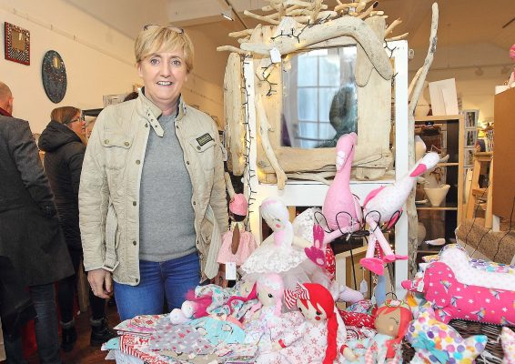 Craft member Karen Miller displaying her handmade dolls