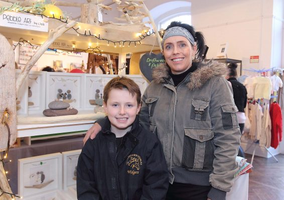 Craft member Lisa Walsh and son Calum with Lisa's Driftwood and Pebble Art